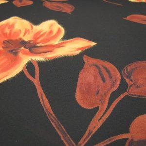 polyester zwart met oranje bloem
